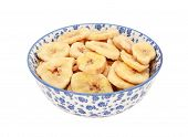 Dried Banana Chips In A Blue And White China Bowl