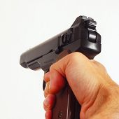 Hand with a army semi-automatic pistol closeup