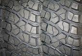 pic of four-wheel  - Four wheel drive tire stack as a background - JPG