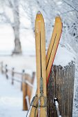 Постер, плакат: Vintage Skis in Snow Scene