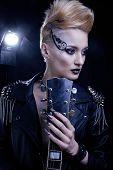 Fashion Rocker Style Model Girl Portrait. Hairstyle. Punk Woman