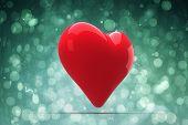 Red heart against blue abstract light spot design