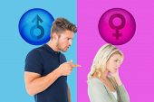 Young couple having an argument against pink and blue