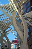 picture of metal sculpture  - Downtown Calgary is a mixture of traditional and modern architecture with art interspersed. This image shows The Trees, a metal sculpture, with the Calgary tower in the background. ** Note: Soft Focus at 100%, best at smaller sizes - JPG