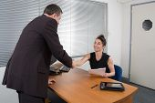 A Female Business Executive Recruiter Smiling At A Man.