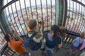 People take photos from St. Peters church tower in Riga, Latvia.