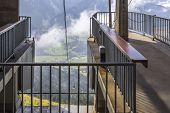 picture of bavarian alps  - view into the valley from a cable car summit station in the bavarian alps - JPG