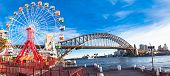 stock photo of bridge  -  Luna park wheel with harbour bridge arch at sunset in Sydney - JPG