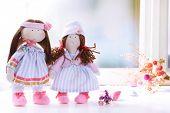 image of rag-doll  - Handmade doll near window close - JPG