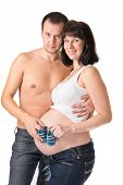 Man And Pregnant Woman Holding Blue Booties