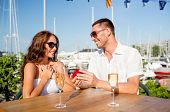 love, dating, people and holidays concept - smiling couple wearing sunglasses with champagne and sma poster