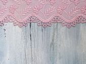 beautiful lace on the blue wooden background