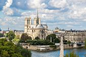 stock photo of notre dame  - Aerial view of Seine and Notre Dame de Paris in summer day - JPG