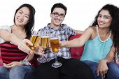 Teenagers Having Fun By Drinking Champagne