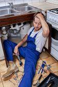 Handyman Sitting On The Kitchen Floor