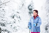 Cross-country skiing: two women cross-country skiing on a winter day (motion blurred image)