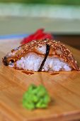 sushi unagi with sauced slice of smoked eel