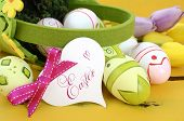 Happy Easter Green And Yellow Felt Basket Of Of Pink, White And Green Easter Eggs On Rustic Vintage