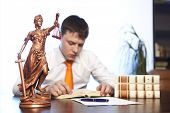 image of lawyer  - Lawyer reading a book in the office - JPG