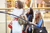 pic of mall  - Three Female Friends Shopping In Mall Together - JPG