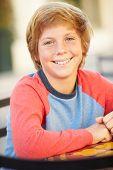 foto of 13 year old  - Portrait Of Smiling Teenage Boy - JPG