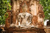 picture of gautama buddha  - Old Buddha Statue and Old Temple Architecture at Wat Mahathat Ayutthaya Thailand World Heritage Site - JPG