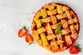 pic of tarts  - overhead view of fresh strawberry pie or tart with berries on white background - JPG