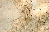 stock photo of loam  - Cracked wall surface of the old wattle and daub house - JPG
