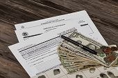 picture of american money  - United States of America citizenship immigration naturalization application process With Public Documents and prop American money for education - JPG