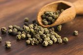 picture of peppercorns  - Green Peppercorns on a wooden background - JPG