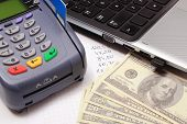 pic of terminator  - Payment terminal with credit card money laptop and financial calculations credit card reader finance concept - JPG