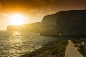 pic of gozo  - Xlendi Bay at sunset in Malta situated in the south west of the island of Gozo - JPG