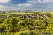 image of west village  - Flat west German landscape near Aachen and Herzogenrath with lots of wind turbines and a village in the foreground - JPG