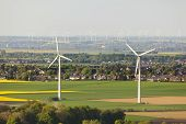 foto of rape  - Flat west German landscape near Aachen and Herzogenrath with wind turbines and yellow rape fields - JPG