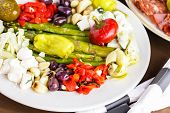 stock photo of antipasto  - Appetizers plate with vegetarian antipasto in Italian restaurant. ** Note: Soft Focus at 100%, best at smaller sizes - JPG
