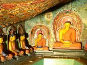 Statues Of Lord Buddha In An Ancient Temple In Sri Lanka