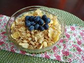 stock photo of cereal bowl  - A bowl of breakfast cereal topped with blueberries - JPG