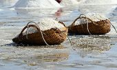 pic of sea salt  - sea salt in the bucket on the salt farmland Thailand - JPG