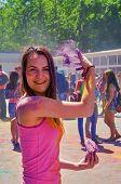image of holi  - happy girl throws powder at Holi Festival  - JPG