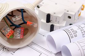 picture of electrical engineering  - Copper wire connections in electrical box rolls of electrical diagrams and electric fuse on construction drawing of house accessories for engineering work energy concept - JPG