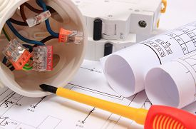 pic of electrical engineering  - Copper wire connections in electrical box rolls of electrical diagrams and electric fuse on construction drawing of house accessories for engineering work energy concept - JPG