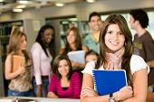 stock photo of student teacher  - student and teacher looking smiling at the library - JPG