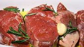 Raw Lamb Marinated In Garlic Olive Oil And Rosemary