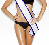 picture of beauty pageant  - part of woman shape of beautiful thigh in bikini with white tape of beauty contest - JPG