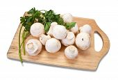 stock photo of shroom  - champignon mushroom with parsley on cutting board - JPG