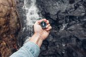 Man Explorer Searching Direction With Compass In Waterfalls, Point Of View Shot poster