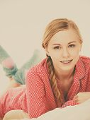 Laziness Relax Concept. Smiling Positive Teen Girl In Bed. Lazy Youthful Female Wearing Red Dotted P poster