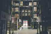 Distribution Storehouse Or Modern Warehouse Exterior With Vintage Tone.low Light Shot poster
