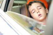 Litle Boy Sleeps In Safe Chair In Car