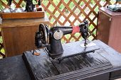 The Old Manual Sewing Machine. The Machine For Stitching Thread Wear. poster
